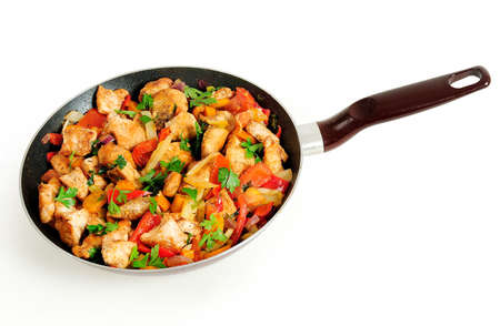 Isolated chicken with vegetable on frying pan photo
