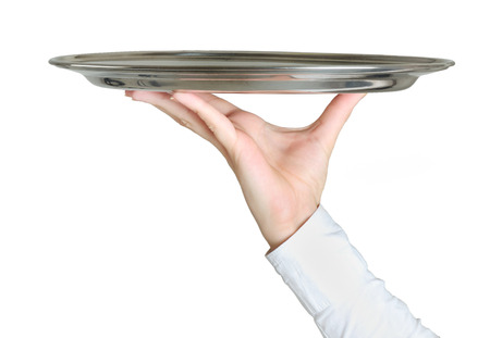 Isolated hand holding empty dish