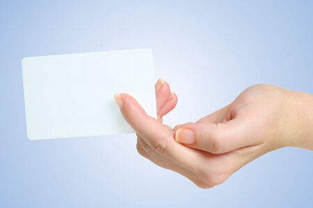 Hand giving a business  card photo
