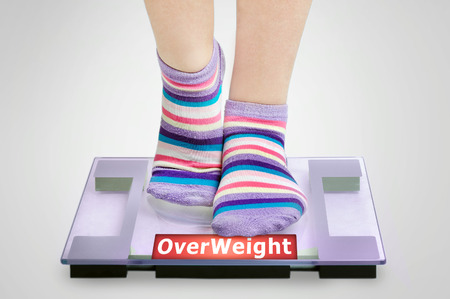 Overweight word on grey scales