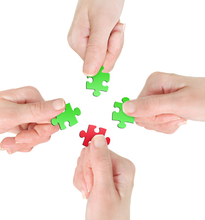 Isolated hand with puzzle on background photo