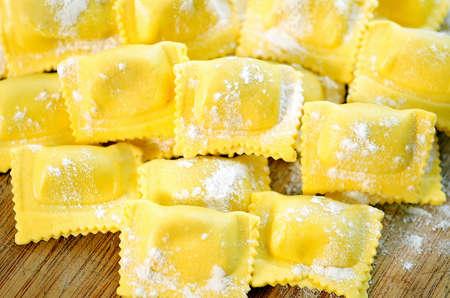 unprepared: Unprepared ravioli on wooden table