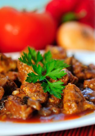 Plate with stew of pork meat