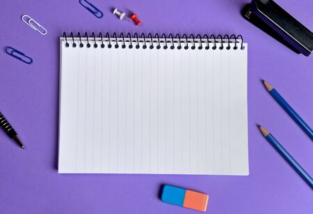 Empty notepad with office supplies photo