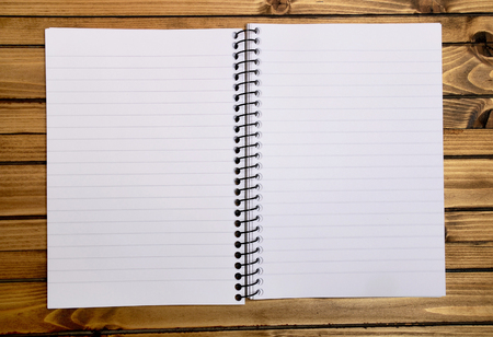 Empty notebook on wooden table photo
