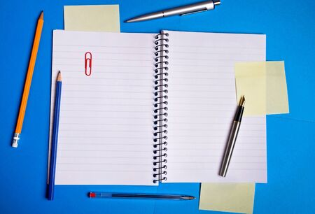 Notebook and office supplies on background photo