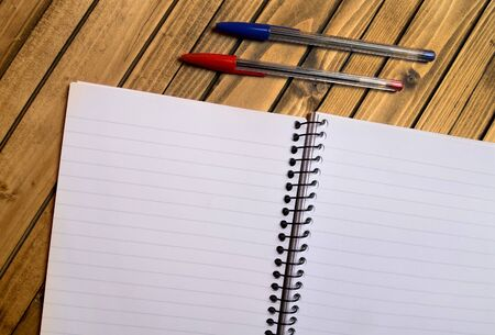 Blank paper with pen on table photo