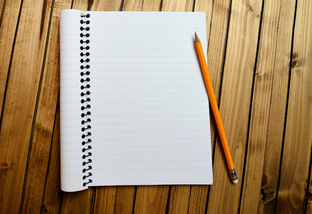 Empty notebook with crayon on table Stock Photo