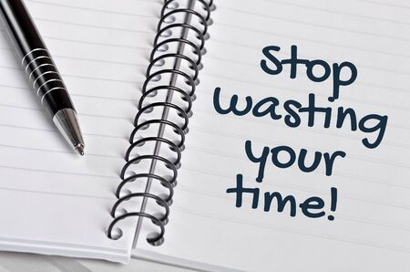 wasting: Stop wasting your time word on notebook page Stock Photo