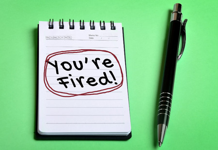 you are fired: You are fired word on notebook page Stock Photo