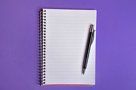 Empty notebook and pen on background photo
