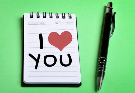 i love you sign: I Love You word on notebook page