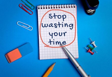Stop wasting your time word on notebook page photo