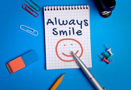 always: Always smile word on notebook page Stock Photo
