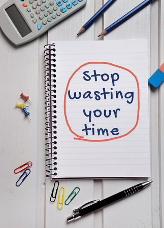writing utensil: Stop wasting your time word writing on paper Stock Photo