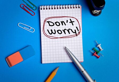 dont worry: Dont worry word writing on paper