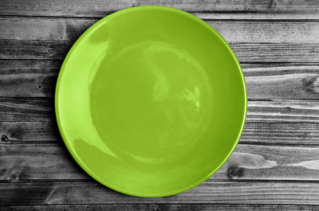 plate: Empty green plate on wooden table