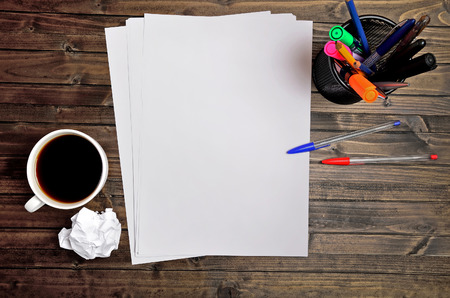 Empty paper with coffee cup on desk