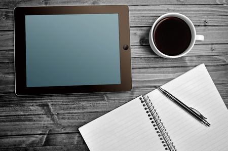 Tablet empty screen with coffee cup and notepad Stock Photo