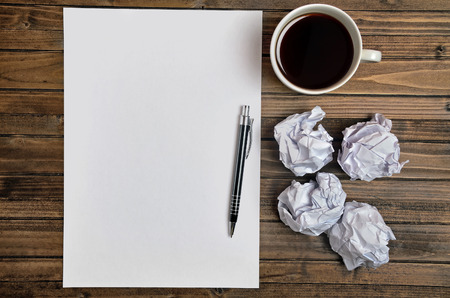 Empty paper with coffee on wooden table Stock Photo