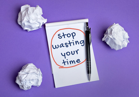 wasting: Stop wasting your time word on notepad Stock Photo