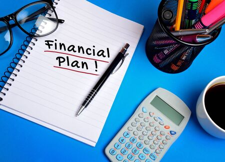 Financial plan word on notepad
