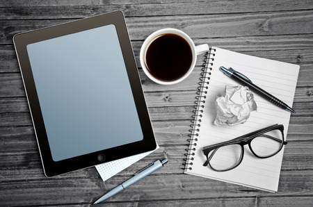 Tablet empty screen with notepad and coffe cup Stock Photo