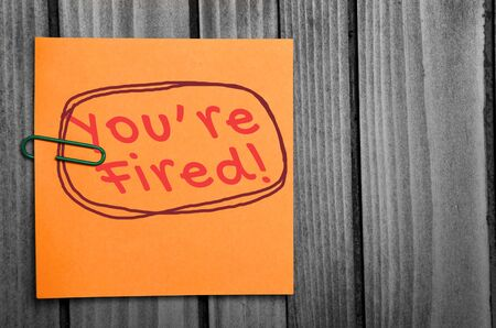 you are fired: You are fired word on orange notes