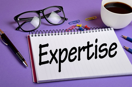 expertise: Expertise word on notepad closeup