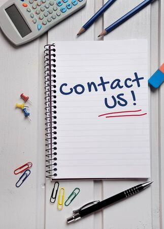 Contact us word on notepad Stock Photo