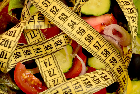 centimeter: Vegetable salad with centimeter on background Stock Photo
