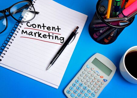 writing desk: Content marketing word on notepad Stock Photo