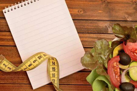 centimeter: Notepad with centimeter and vegetable salad