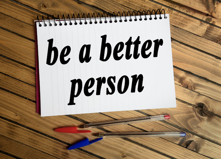 better: Be a better person word on notepad Stock Photo