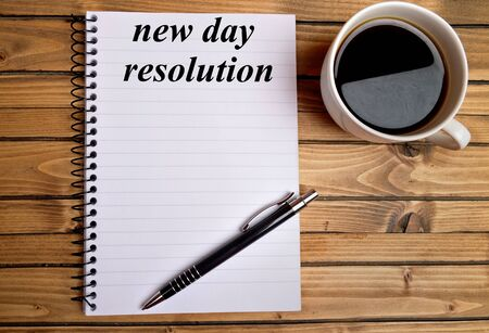 new day: New day resolution word on notepad