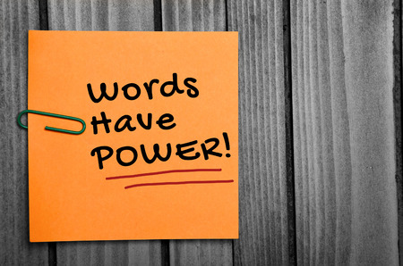 Words have power word on orange notes Imagens