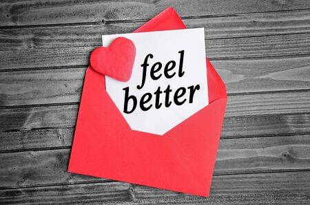 by feel: Feel better word on white paper