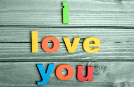 te amo: Colorful I love you word on blue wooden table
