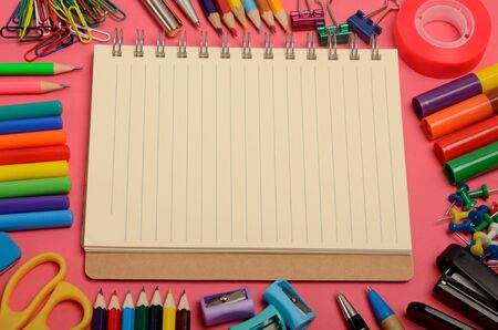 background stationary: Closeup school office supplies on pink background