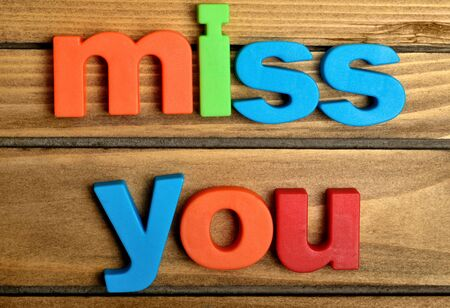 miss you: Colorful miss you word on wooden table Stock Photo