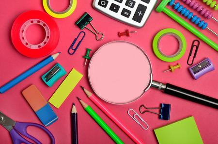 pink background: School supplies on pink background