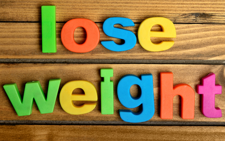 weightloss plan: Colorful lose weight word on wooden table