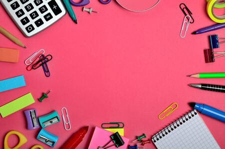 background stationary: School and office supplies on pink background Stock Photo