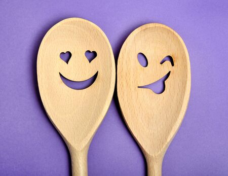 background people: Lovely wooden spoon on purple background