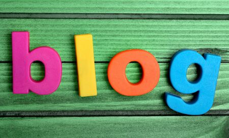 BLOG: Colorful blog word on green wooden table Stock Photo