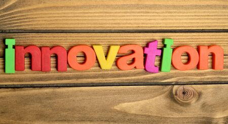innovation word: Colorful innovation word on wooden table Stock Photo