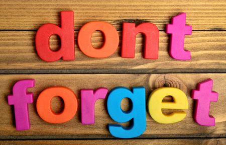 Colorful Dont Forget word on wooden table