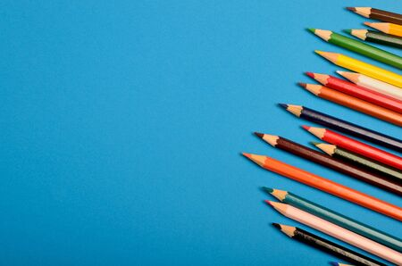 coloured background: Group of colorful pencils on blue background Stock Photo