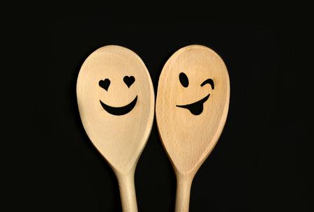love shape: Lovely wooden spoon on black background Stock Photo