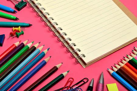 text pink: Notebook with school accessories on pink background Stock Photo